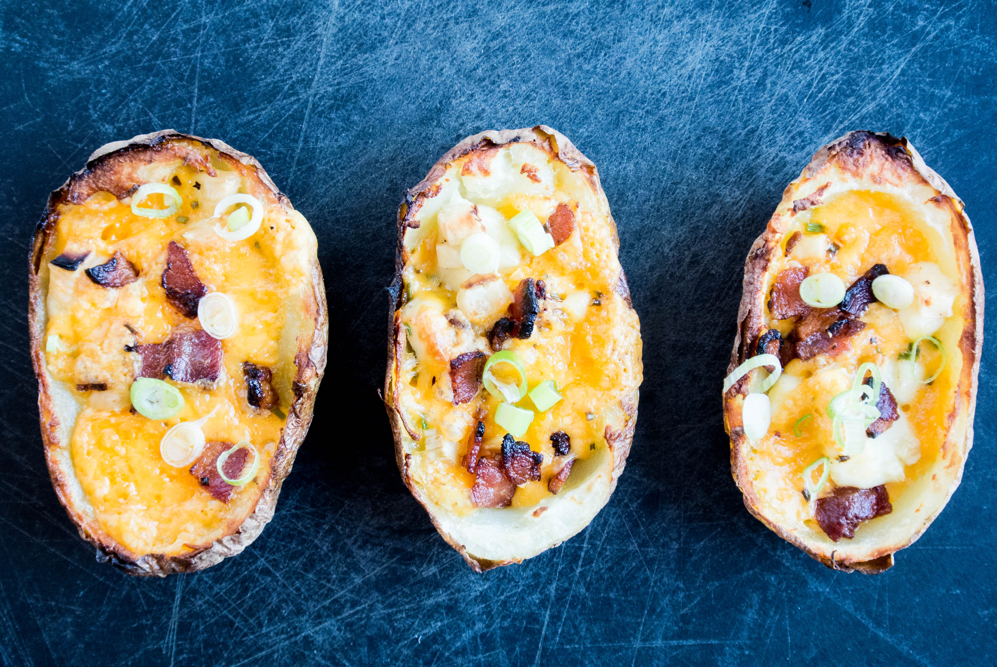 Potato Skins with Cheese, Chives + Bacon